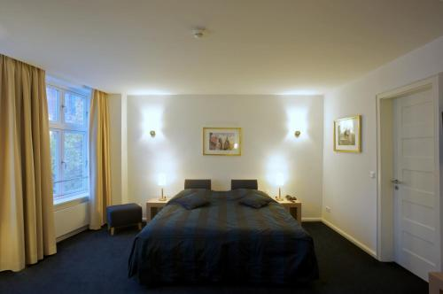 En eller flere senge i et værelse på Hotel Bremer Hof