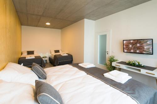 A bed or beds in a room at Residence Trafick