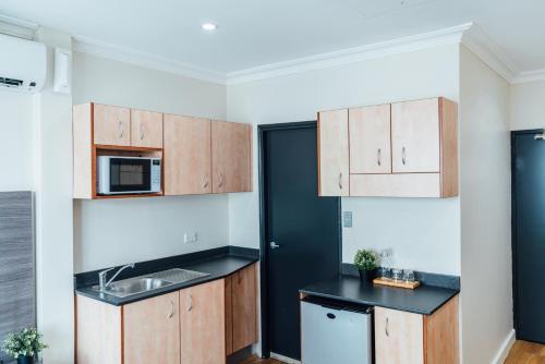 A kitchen or kitchenette at UNO Hotel Sydney