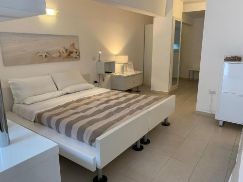 A bed or beds in a room at Abitare in Vacanza