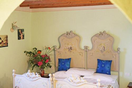 Letto o letti in una camera di Palazzo di monteoliveto