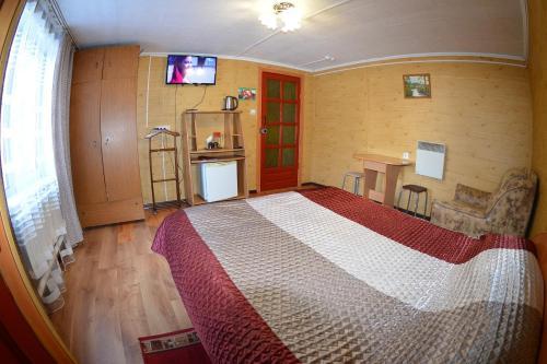 Кровать или кровати в номере Алтын Туяк