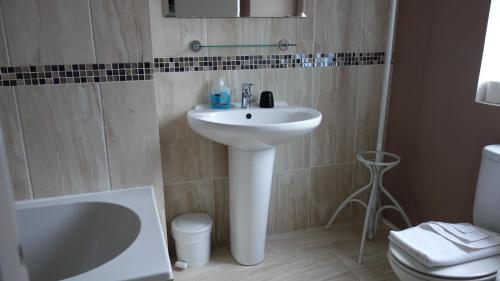 A bathroom at Kensington Hotel