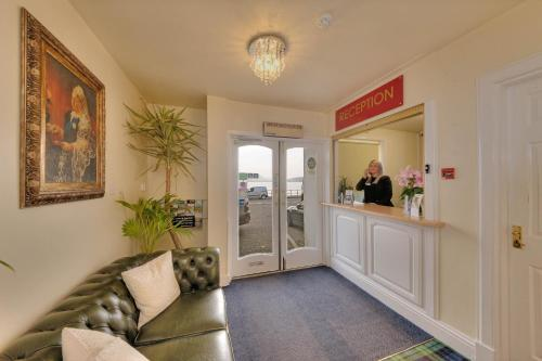 The lobby or reception area at Best Western Muthu Queens Oban Hotel