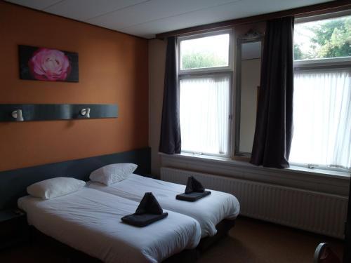 Un ou plusieurs lits dans un hébergement de l'établissement Zorn Hotel Duinlust