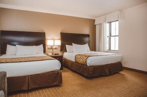 A bed or beds in a room at Chicago South Loop Hotel