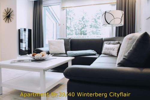 A seating area at Apartment Winterberg Citylife oder Cityflair free Wifi, PS4, Netflix