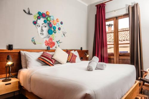 A bed or beds in a room at Selina Plaza De Armas Cusco