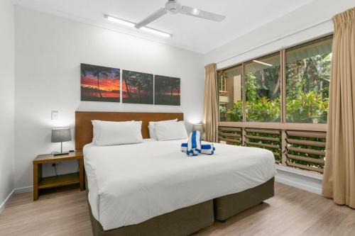 A bed or beds in a room at Amphora Resort Private Apartments