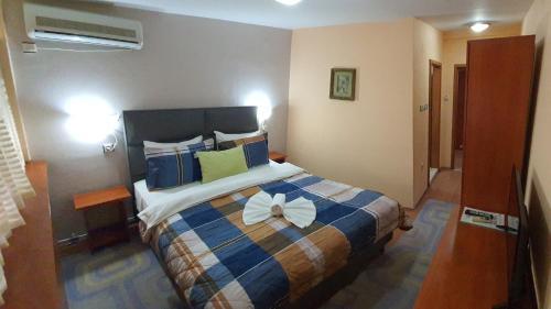 Posteľ alebo postele v izbe v ubytovaní Hotel Square