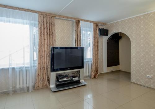 Телевизор и/или развлекательный центр в Park Hotel Uralsk