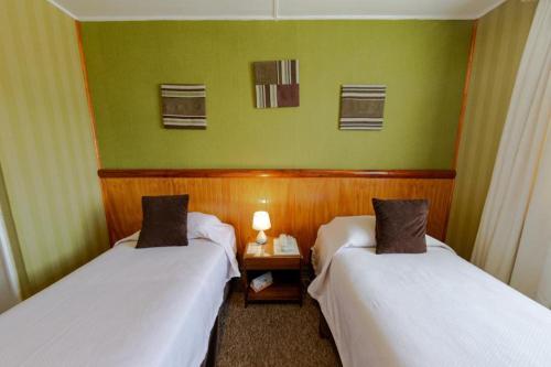 Cama o camas de una habitación en Hotel Capitán Eberhard