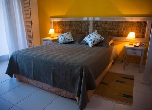 Cama ou camas em um quarto em Pousada da Foca