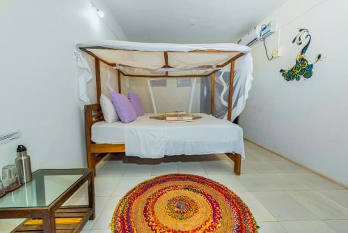 A bed or beds in a room at Simrose