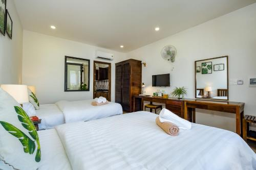 A bed or beds in a room at Melica Resort