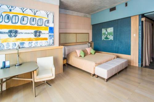 Кровать или кровати в номере Апарт-отель Garden Embassy