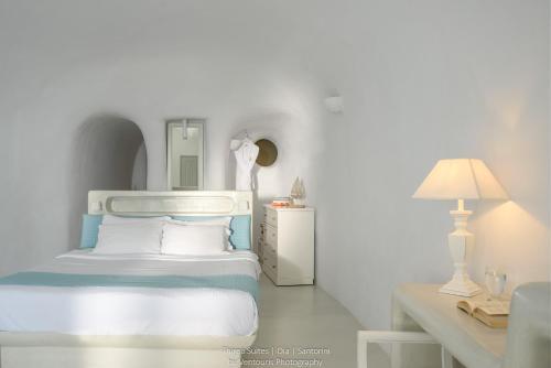 Un ou plusieurs lits dans un hébergement de l'établissement Thirea Suites