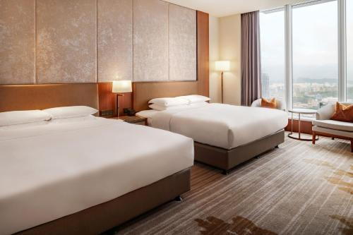 A bed or beds in a room at Courtyard by Marriott Taipei