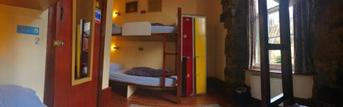 A bunk bed or bunk beds in a room at High Street Hostel