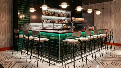 The lounge or bar area at Delta Hotels by Marriott Vancouver Downtown Suites