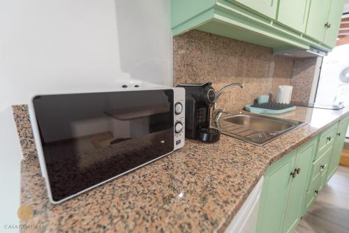 A kitchen or kitchenette at Casa do Foral
