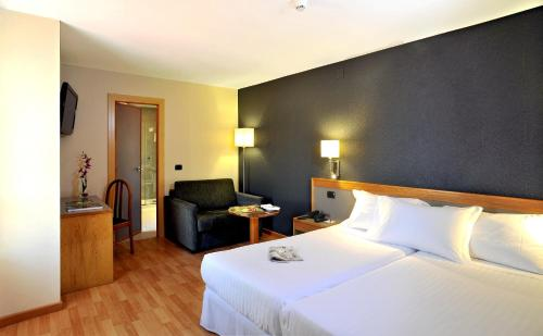 A bed or beds in a room at Civis Jaime I
