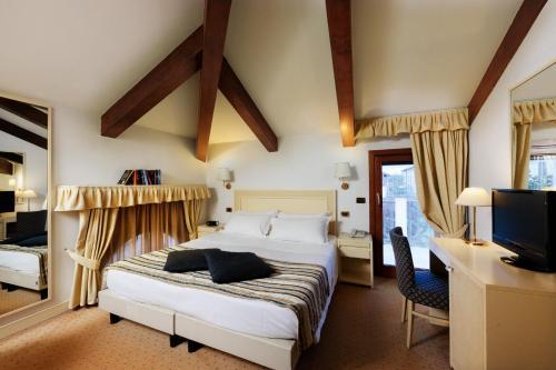 Un ou plusieurs lits dans un hébergement de l'établissement Hotel Giudecca Venezia