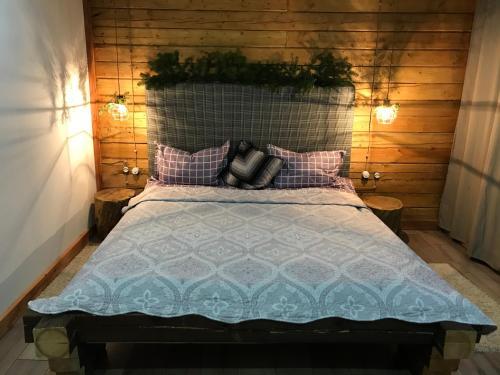 Кровать или кровати в номере Гостевой дом Альпхаус