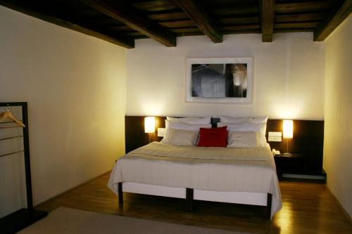 Ein Bett oder Betten in einem Zimmer der Unterkunft Domus Balthasar Design Hotel