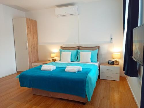A bed or beds in a room at Apartments Wallas
