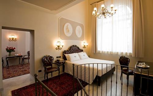Cama o camas de una habitación en Park Hotel Pacchiosi