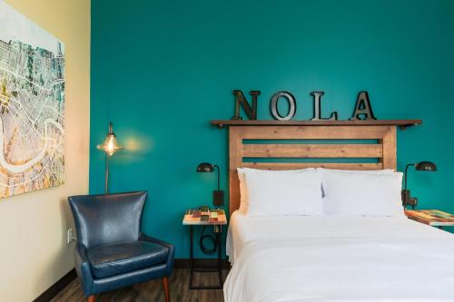 A bed or beds in a room at HI New Orleans Hostel