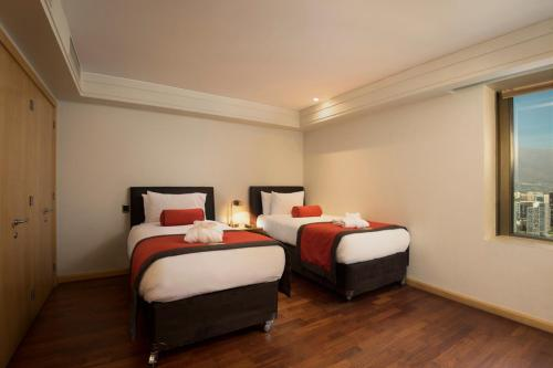 A bed or beds in a room at Boulevard Suites Ferrat
