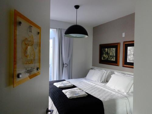 Ein Bett oder Betten in einem Zimmer der Unterkunft Pousada dos Chás Hotel Boutique