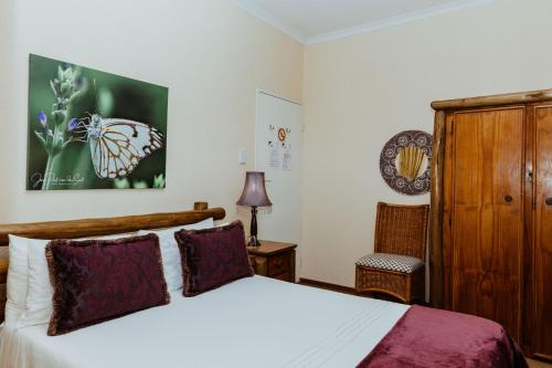 A bed or beds in a room at Boubou Bed and Breakfast
