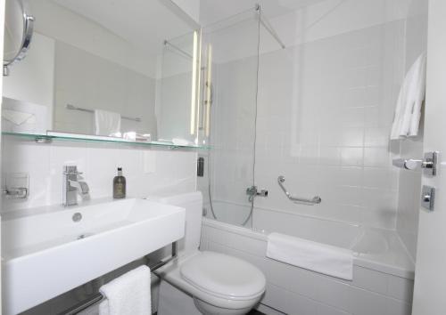 Ванная комната в Hotel Belair