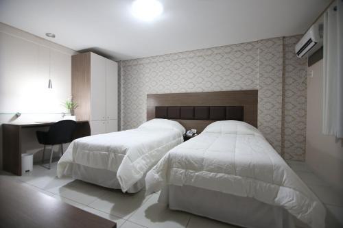 Кровать или кровати в номере Hotel Village Premium Campina Grande