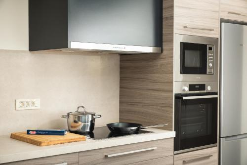 A kitchen or kitchenette at Amaré Chania Luxury Residence