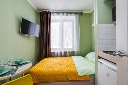 A bed or beds in a room at Стильная студия в 1 минуте от Кутузовского проспекта!