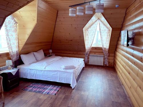Кровать или кровати в номере Гостевой Дом Красная Усадьба