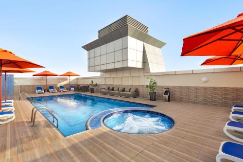 The swimming pool at or near Ramada by Wyndham Dubai Deira
