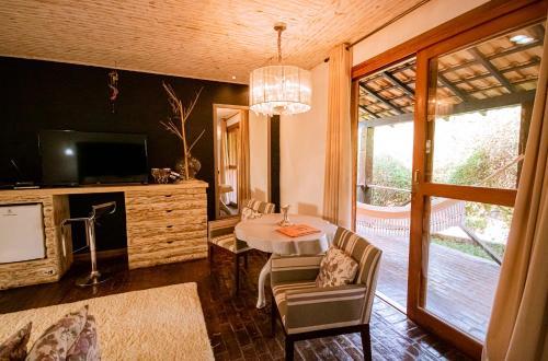Uma área de estar em Pousada Villa 3 Lagos