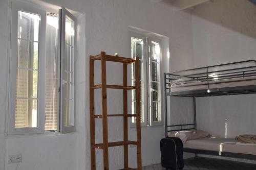 A bunk bed or bunk beds in a room at Refugi Biniati Vell