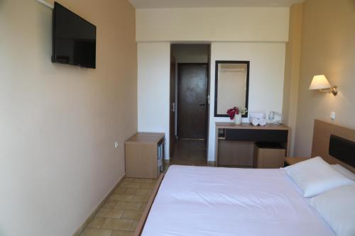 A bed or beds in a room at Rhodian Sun Hotel