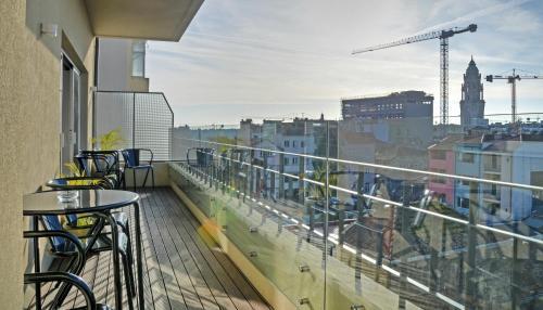 Een balkon of terras bij Hotel Spot Family Suites