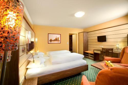 Ein Bett oder Betten in einem Zimmer der Unterkunft Kur- und Wellnesshotel Förch