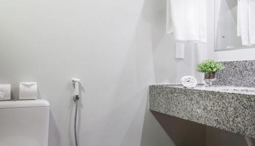 Um banheiro em Cambirela Hotel