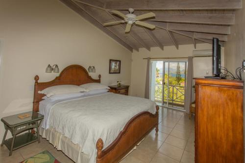 A bed or beds in a room at Mount Nevis Hotel