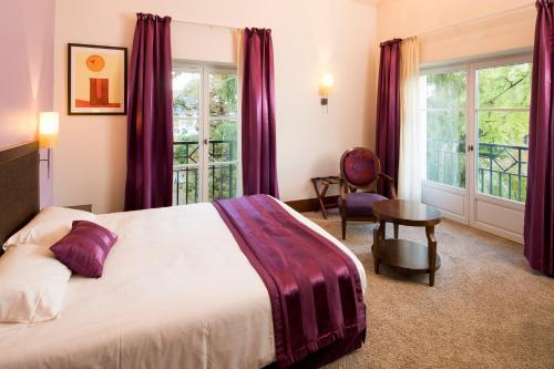 Un ou plusieurs lits dans un hébergement de l'établissement Le Clos Rebillotte