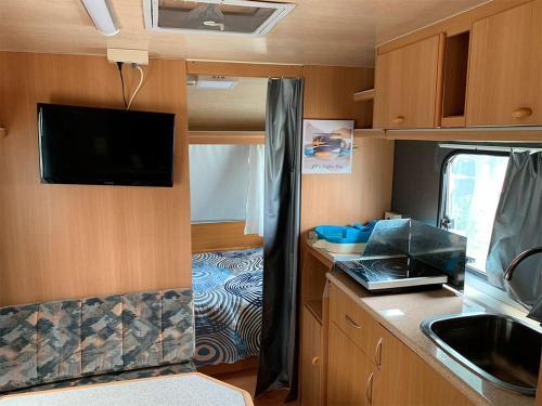 Una cocina o zona de cocina en Camping Santa Tecla